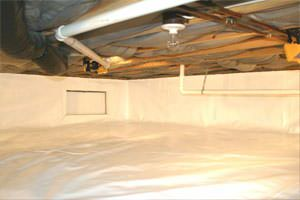 An energy efficient, insulated crawl space with a vapor barrier installed.